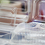 stack of clear plastic clamshell packaging