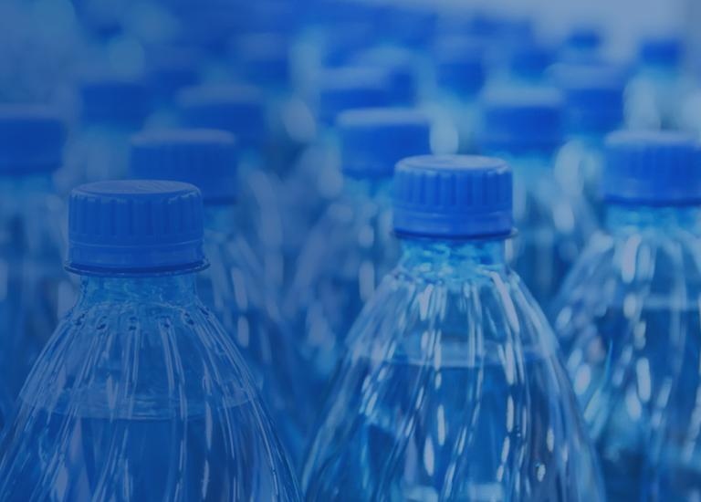 blue water bottles on conveyor in packaging facility