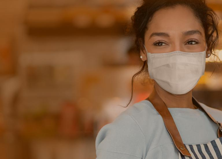 waitress in face mask in restaurant