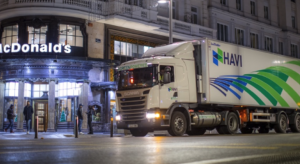 HAVI truck outside an urban McDonald's at night